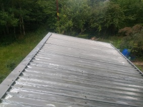 Stripping and re-coating a garden bothy roof. Previously plastisol. Coating removed by wire brush and coated in Peganox.
