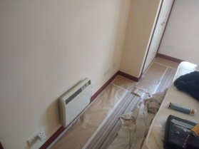Proper precautions to protect the carpet and allow painting right to the bottom of the skirtings. Masking paper is forced under the skirtings right around the room.