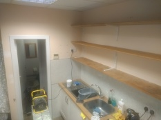 Walls a bit yellow, shelves in need of protection. Deeside Deli before it's freshen up.