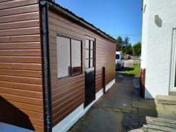 Shed looking much better after re-painting in zinsser allcoat.